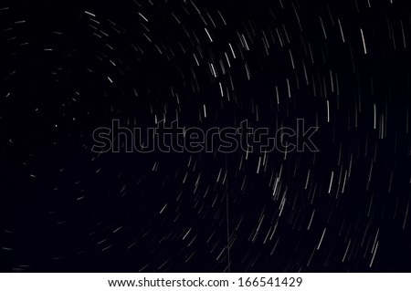 Star trails in the sky taken with a long exposure. Can be used as background.