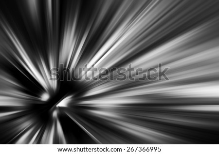 Starburst with radial blur in black and white, for motifs of origin, expansion, or contraction in decoration and backgrounds - stock photo