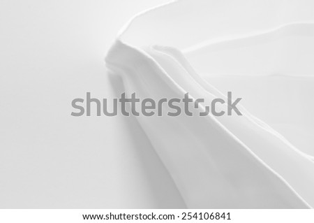 starched standing white cloth napkin