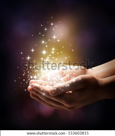 stardust and magic in your hands - stock photo