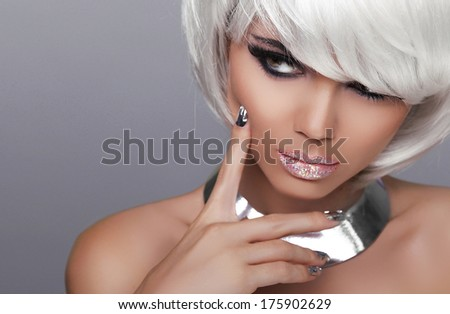 Stare. Fashion Blond Girl. Beauty Portrait Sexy Woman. White Short Hair. Isolated on Grey Background. Face Close-up. Hairstyle. Fringe. Vogue Style. - stock photo