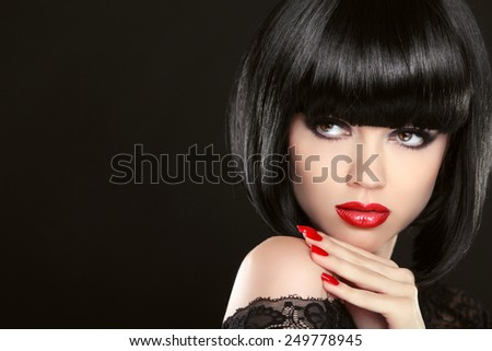 Stare. Fashion model girl face, beauty woman make up and red manicure. Bob black hairstyle. Brunette woman posing over black background. - stock photo