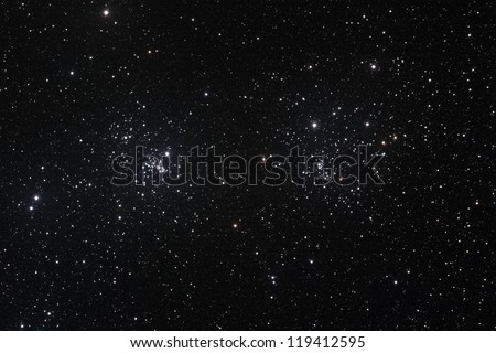 Starfield with The Double Cluster (Cadwell 14) in the constellation of Perseus formed by two open clusters NGC 884 and NGC 869. - stock photo