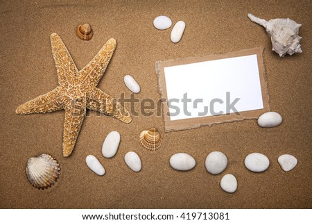 Starfish and shells with frame on the beach, vacation memories with your text - stock photo