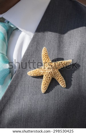 starfish boutonniere on suit for beach wedding - stock photo