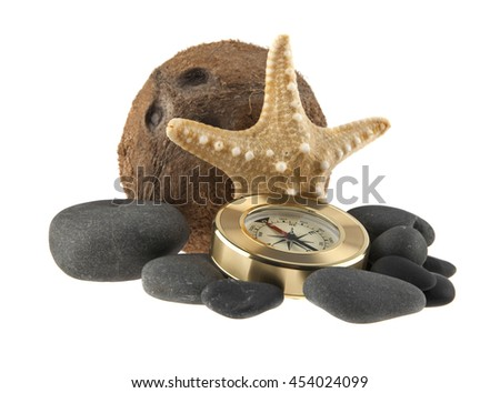starfish, coconut, stones, and compass isolated on white background