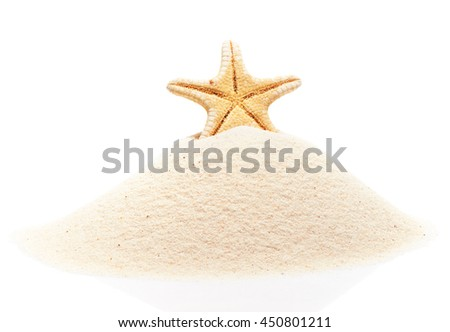 Starfish on pile of beach sand isolated on white background - stock photo
