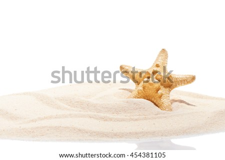 Starfish on sand. Summer beach background - stock photo