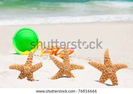 starfish playing at the beach - stock photo