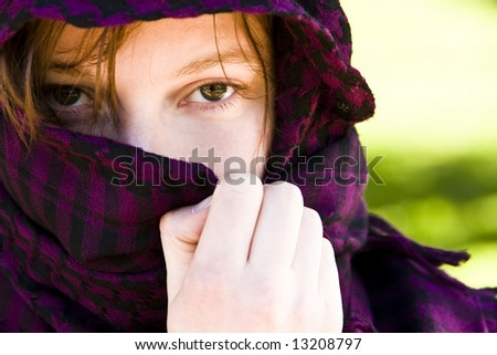 Staring woman portrait covered by veil - stock photo