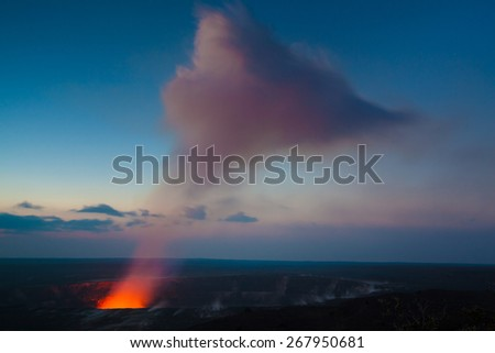 Starry night photos of erupting volcano in Hawaii Volcanoes National Park, Big Island, Hawaii. Night photos, multiple minute exposure. - stock photo