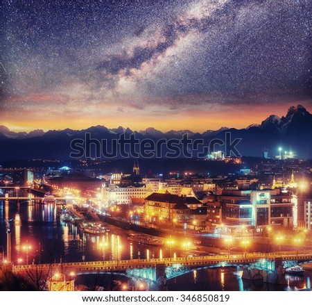 Starry night sky and a view of the Vltava River and Bridges in Prague, Czech Republic - stock photo