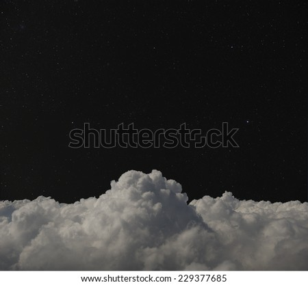 Starry night sky over clouds. - stock photo