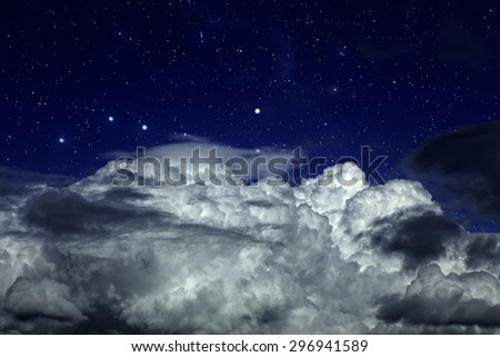 Starry night sky with strong clouds in the foreground - stock photo