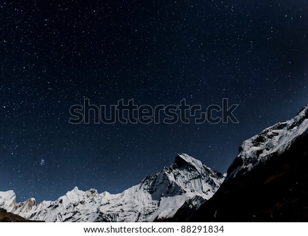 Starry sky over Machhapuchre - Nepal, Himalayas - stock photo