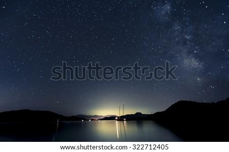 Stars and boats at night  - stock photo