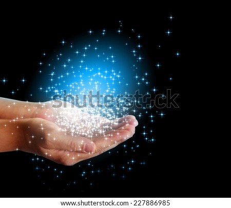 stars and magic in your hands  - stock photo