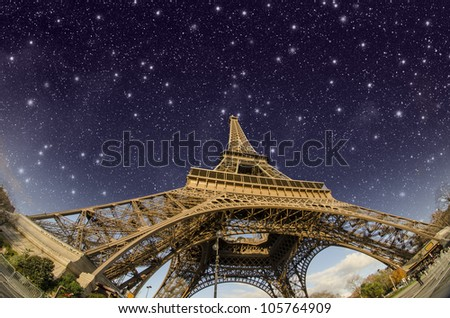 Stars and Night Sky above Eiffel Tower in Paris, France - stock photo