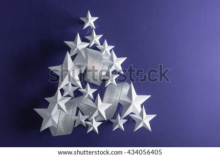 Stars and ribbon form a Christmas tree - stock photo
