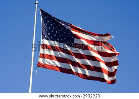 Stars and stripes flying in the wind on deep blue sky nice background for a patriotic display - stock photo