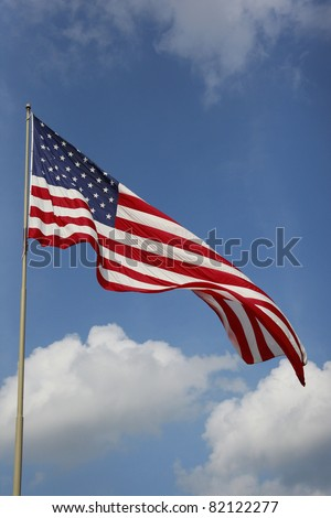 Stars and stripes jumbo american flag waving outdoors on a beautiful day - stock photo