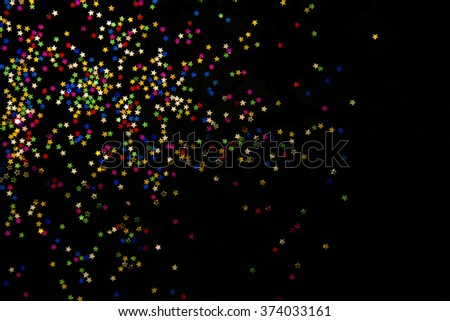 Stars concept isolated against a black background with colorful.