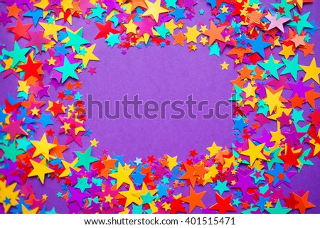 stars confetti on a purple background  - stock photo