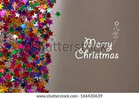 stars confetti on gray background  - stock photo