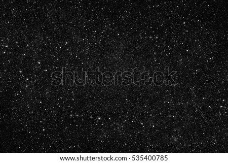 Stars in darkness. Abstract space background. Elements of this image furnished by NASA