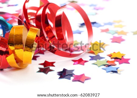 Stars in the form of confetti with streamers on white - stock photo