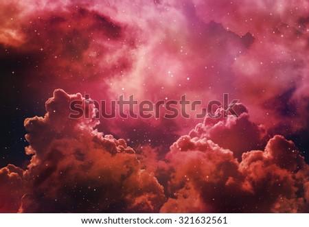 Stars in the night sky orange background. - stock photo
