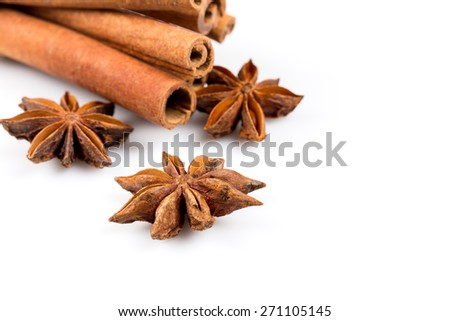 Stars of anise and cinnamon on white background - stock photo