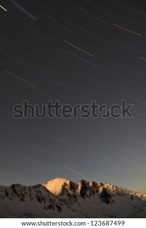 Stars on the sky and moon rising over the mountains, Retezat mountains, Romania - stock photo