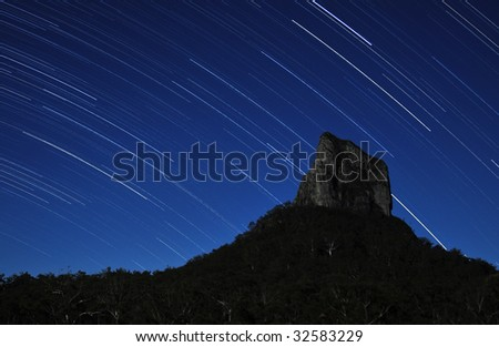 Stars over Mount Coonowrin - stock photo