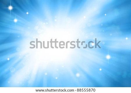 Stars sparkling on blue background - stock photo