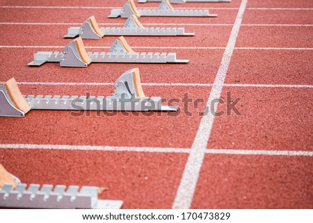 Start blocks on athletics lane - stock photo