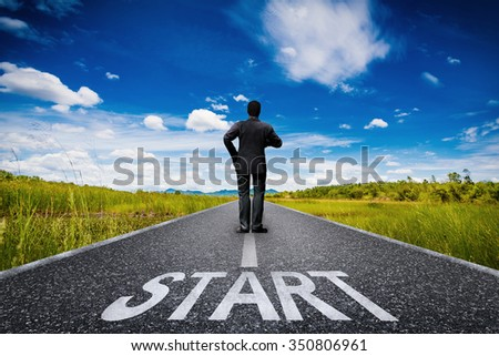 start concept with text and silhouette man on long road  - stock photo