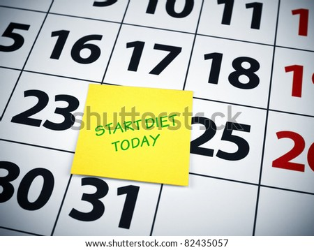 Start diet today written on a sticky note on a calendar. - stock photo