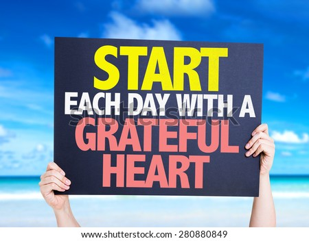 Start Each Day With a Grateful Heart card with beach background - stock photo
