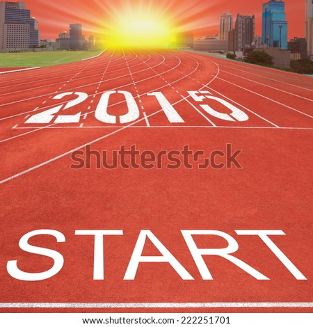 Start forward to 2015 new year. Concept on empty, open road on sunrise sky at red road of  new city. - stock photo