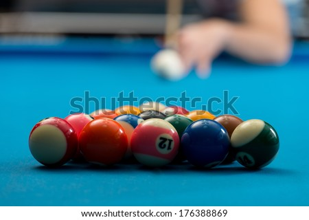 Start Game - Person Playing Billiards Lined Up To Shoot Easy Winning Shot - stock photo