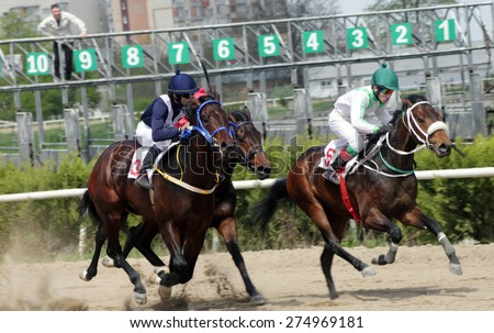 Start gates for horse races for the prize of Spring in Caucasus, Russia. - stock photo