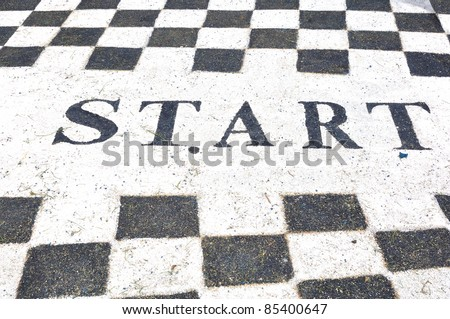 Start label on jogging lane in garden - stock photo