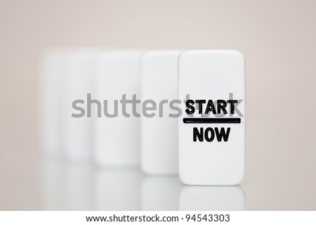 Start now on a set of blank dominoes - stock photo