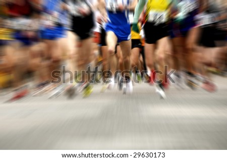 start of a marathon race with strong zoom panning effect - stock photo