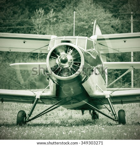 Start of the engine of the old retro plane. - stock photo