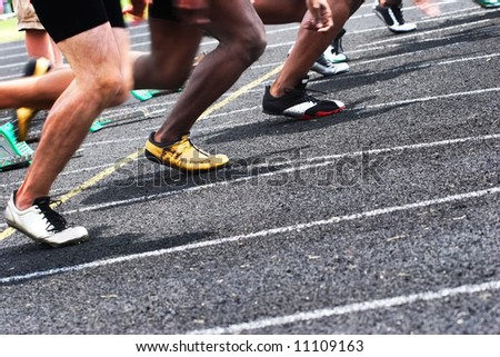 Start of the race (some motion blur, focus on the yellow shoe) - stock photo