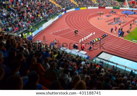 Start of the sprint on the stadium. Nice sport wallpaper for olympic game in Rio.  - stock photo