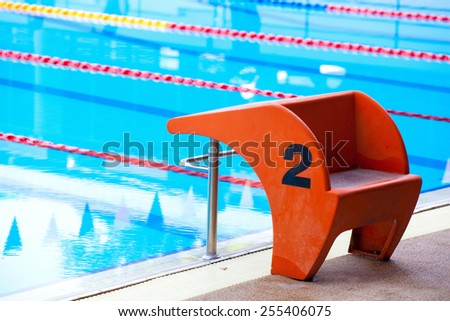 Start position with number 2 in competition swimming pool. - stock photo