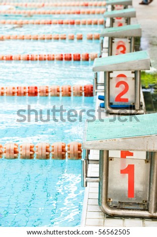 Start position with numbers  in competition swimming pool. - stock photo